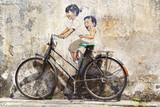 """Fototapeta """"Małe dzieci na rowerze""""."""