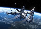 Kosmiczny wahadłowiec i stacja kosmiczna w przestrzeni kosmicznej