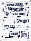 Różnorodni kiści farby graffiti na ściana z cegieł. Rama z czarnymi plamami atramentu. Spray grunge background.