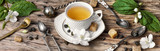 plakat z herbatą z kwiatami jaśminu