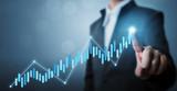 Biznesowy rozwój sukces i narastający wzrostowy pojęcie, biznesmen wskazuje kreskowego kropka wykresu korporacyjnego przyszłościowego wzrostowego plan