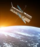Teleskop kosmiczny na orbicie planety Ziemia. Wschód słońca. Układ Słoneczny. Niektóre elementy tego obrazu są dostarczane przez NASA