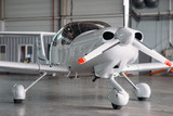 Small private turbo-propeller airplane in hangar