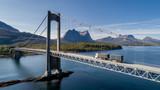Zdjęcia lotnicze mostu nad Efjord z ciężarówką i górskich Stortinden w tle, Ballangen, Norwegia