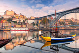 Porto, Portugal. Cityscape image of Porto, Portugal with reflection of the city in the Douro River during sunrise.