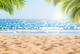 Abstract seascape with palm tree, tropical beach background. blur bokeh light of calm sea and sky. summer vacation background concept.