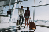 Loving couple is waiting for flight at airport