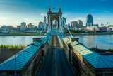 Panoramic view of Cincinnati downtown with the historic Roebling suspension bridge over the Ohio river