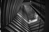 Black-and-white shot of the inside of a skyscraper and the pattern the levels create