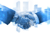 Deal. business man shaking hands with effect world map global and network link connection graphic diagram blue color tone, digital technology, internet communication, teamwork, partnership concept