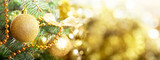 Christmas background. Christmas tree decorated with golden balls on blurred background