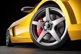 Yellow sports car . Wheel and brakes closeup. 3d render