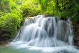 Wonderful  tiers of waterfall motion in deep jungle, Located Erawan waterfall Kanchanaburi province, Thailand