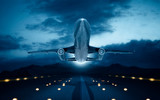 Jet plane in flight with dark blue