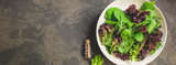 Healthy salad, leaves mix (mix micro greens, arugula, onion, other ingredients). food background. copy space