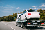 Car Service Transportation Concept. Tow Truck Transporting Car Or Help On Road Transports Wrecker Broken Car. Auto Towing, Tow Truck For Transportation Faults And Emergency Cars . Tow Truck Moving In