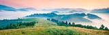 Foggy morning panorama of mountains valley. Splendid summer sunrise in Carpathian mountains, Rika village location, Transcarpathian, Ukraine, Europe. Beauty of nature concept background.