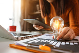 business hand showing creative business strategy with light bulb as concept