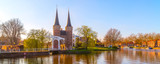 Delft, Netherlands Oostpoort or Eastern Gate domes, canal and reflection in Holland, panoramic banner