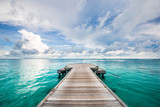 Dramatic black and white process for loneliness or inspiration. Perspective view at sea from center of wooden pier dramatic sky at daylight.
