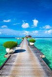 Maldives water bungalows resort at islands beach. Indian Ocean, Maldives. Beautiful sea landscape, luxury resort and  sky. Beach  under wonderful sky