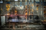 Old rusted wall with covered up graffiti