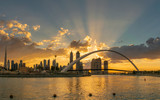 A beatiful sunrise from Dubai Canal, focusing on the second pedestrianbridge measures 205x6.5 metres and the floor of the bridge is constructed in an S-Curve shape. The pedestrian bridge is suspended