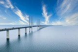 Aerial view of the bridge between Denmark and Sweden, Oresundsbron during bright sunny day.