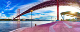 Lisbon landscape at sunset.Panoramic photograph of the 25 de Abril bridge in the city of Lisbon over the Tajo River