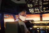airplane pilot in a medical mask on his face
