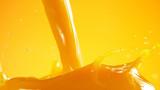 Orange juice splash on coloured background