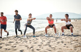Group of friends  is exercise on the beach by the sea.fitness, sport and healthy lifestyle concept