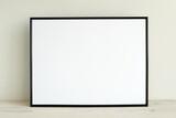 Simple minimal black horizontal frame mockup on light wood shelf, frame mock up in living room for design presentation.